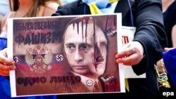Плакат учасників протесту проти агресії Росії. Мілан, 9 червня 2015 року