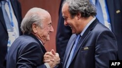 FIFA President Sepp Blatter (left) has slammed the UEFA head Michel Platini (right) over a corruption investigation into the workings of world soccer's governing body.