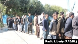 Afghan voters wait in a queue to cast their ballots in the northern Kunduz Province on October 20.