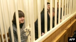 Suspects in the murder trial of journalist Anna Politkovskaya sit in the defendants' cage in a Moscow court.