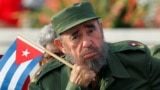 Cuba -- Cuban President Fidel Castro listens to a speaker during the May Day parade in Havana's Revolution Square, May 1, 2005