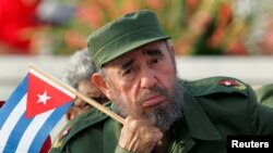 Cuban President Fidel Castro listens to a speaker during the May Day parade in Havana's Revolution Square in 2005.