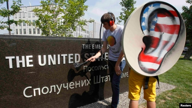 Activists from the Internet Party of Ukraine perform during a rally supporting Edward Snowden, a former contractor at the National Security Agency (NSA), in front of the U.S. Embassy in Kyiv on June 27.