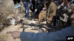 Группа вооруженных людей в Ливии. Иллюстративное фото.