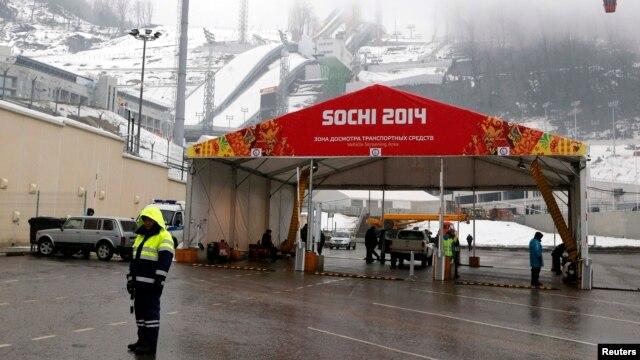A police officer stands near a checkpoint at the RusSki Gorki Ski Jumping Center in Krasnaya Polyana near Sochi.