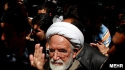 "Hossein Karrubi said a deputy minister said opposition leader Mehdi Karrubi (pictured) ""should have been executed a long time ago."""
