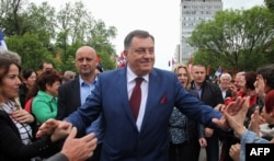 Republika Srpska President Milorad Dodik presses the flesh in Banja Luka last year (file photo)