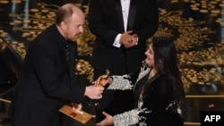 Journalist and filmmaker Sharmeen Obaid Chinoy accepts her award for Best Documentary Short Subject, A Girl in the River from actor and comedian Louis C.K. onstage at the 88th Academy Awards in Hollywood on February 28.