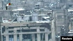 A screen grab from Syrian television shows damaged buildings covered in snow in the besieged Baba Amro district of Homs, purportedly on March 2.