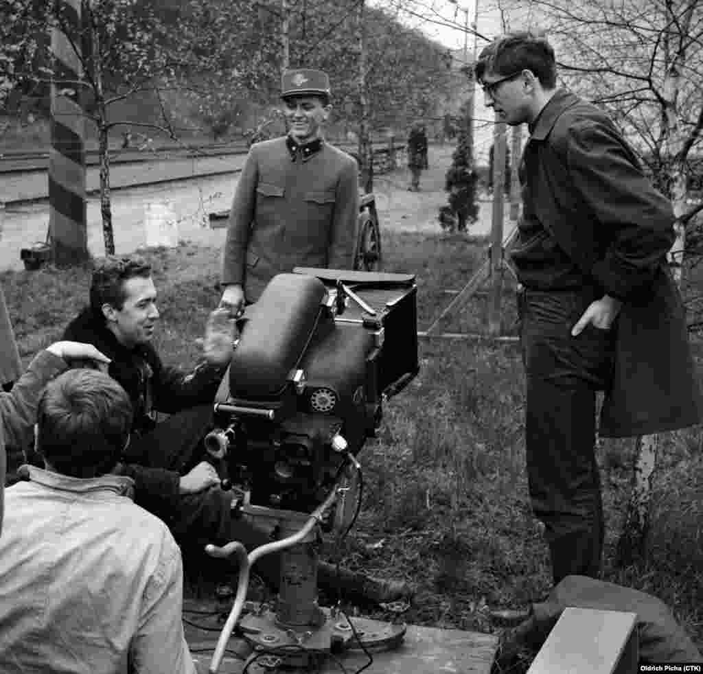 Filming of the Oscar winning movie Ostre sledovane vlaky (Closely Watched Trains) based on Hrabal´s novel in 1966. Film director Jiri Menzel, right, pop singer Vaclav Neckar playing Milos Hrma, center, and director of photography Jaromir Sofr, left.
