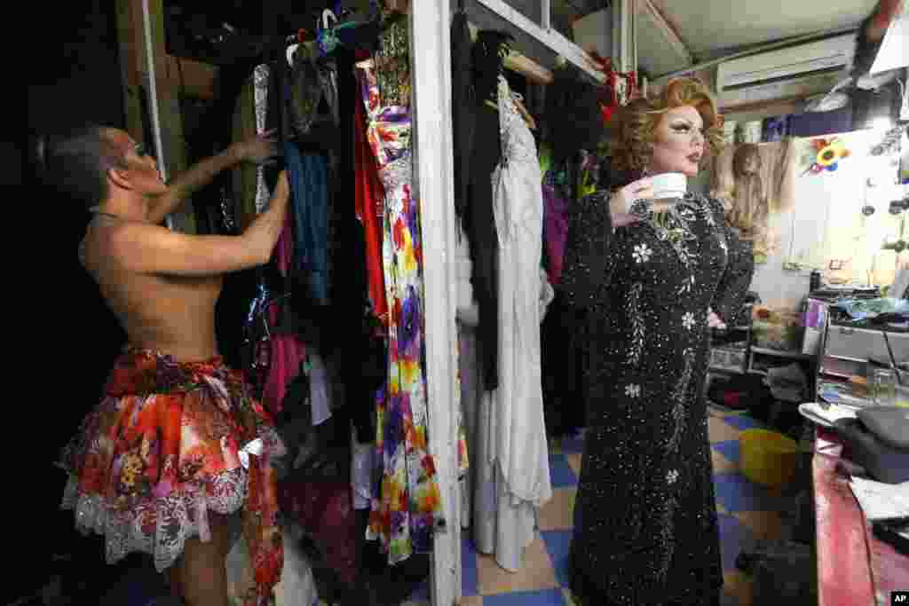 A wardrobe change during a break in the cabaret show.