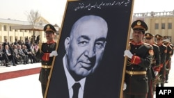 Army officers carry a portrait of late Afghan President Sardar Muhammad Daud during his funeral in Kabul in March 2009.