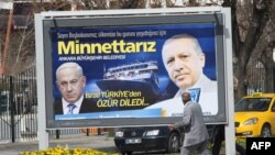 "A billboard in Ankara, the Turkish capital, shows Prime Minister Recep Tayyip Erdogan (right) and his Israeli counterpart, Benjamin Netanyahu, and reads: ""We are grateful to you,"" a reference to Netanyahu's apology."