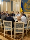 Ukrainian President Volodymyr Zelenskiy (center right) attends a meeting with lawmakers in Kyiv on May 21.