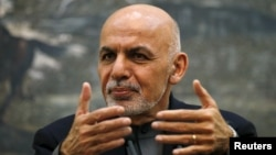 Afghan President Ashraf Ghani speaks during a news conference in Kabul on December 7