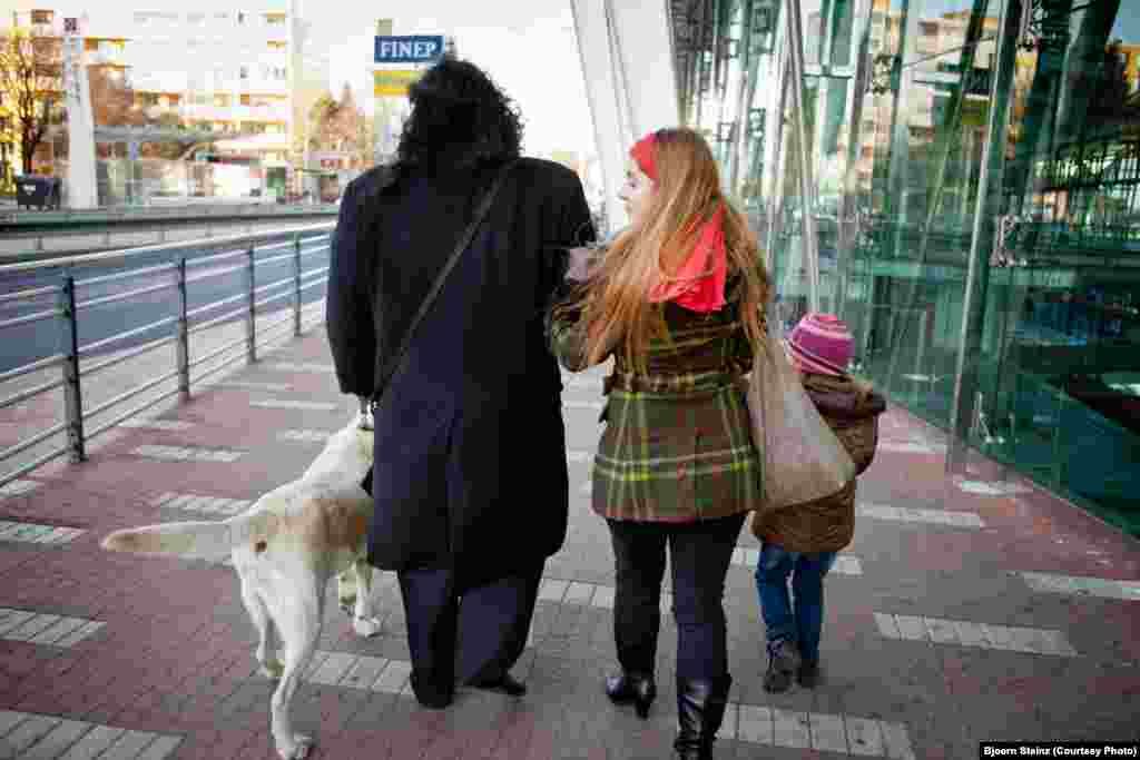 Bihari and his family walk through Prague.