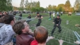 RUSSIA---YEKATERINBURG/ People pull down a fence as they protest against the construction of St Catherine's Cathedral in central Yekaterinburg. The church is to be built by 2023 to mark the 300th birthday of the city of Yekaterinburg. Donat Sorokin/TASS