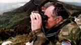BOSNIA-HERZEGOVINA -- Bosnian Serb wartime general Ratko Mladic monitors a battle against Muslim forces near the eastern Bosnian town of Gorazde, April 16, 1994
