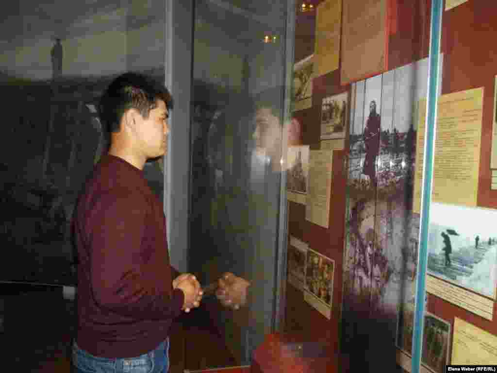 In the Hall of Remembrance, a visitor reads about those who died in the KarLAG.