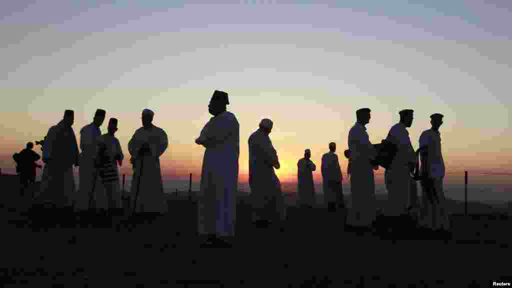 Members of the Samaritan sect take part in the traditional pilgrimage marking the holiday of Passover atop Mount Gerizim near the West Bank city of Nablus. (Reuters/Ammar Awad)