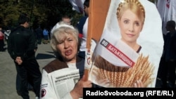 A Tymoshenko supporter holds up a portrait of the jailed former prime minister at a protest outside a courthouse in Kharkiv last week.