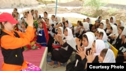 An actress from the Bond Street Theatre teaches pantomime to Afghan girls.