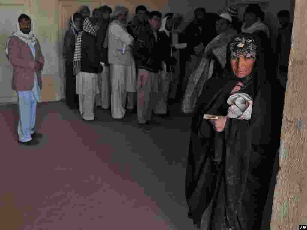 A near-record 3.2 million people returned to their homes in 2011, the UN says. This Afghan woman, seen at a registration center in Herat, was repatriated from Iran.