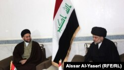 Iraq - Muqtada al-Sadr with Ammar al-Hakim during their meeting, Najaf, 23Jan2015
