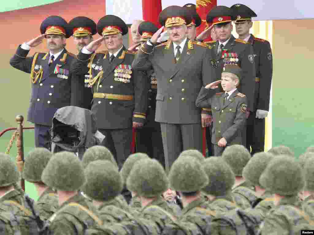 Belarusian President Alyaksandr Lukashenka (front, second from right), accompanied by his son Nikolai, watches a military parade during celebrations marking Independence Day in Minsk.Photo by Nikolai Petrov for Reuters