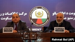 Afghan intelligence chief Masoom Stanekzai (right) and Interior Minister Wais Barmak hold a news conference in Kabul on February 1.