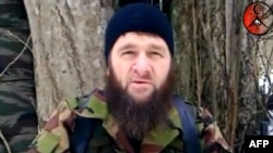 A screen grab shows a man identified as Chechen rebel leader Doku Umarov recording an appeal at an undisclosed location