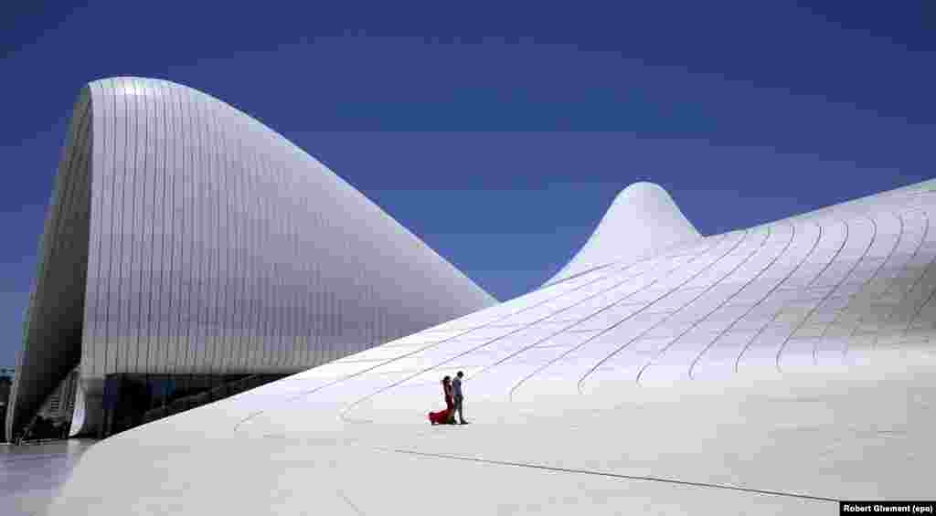 The curving lines of the Heydar Aliyev Center in downtown Baku. The complex is named after the father of Azerbaijan's current president. Azerbaijan has lived under the Aliyev family name since 1969.