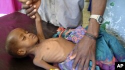 The fighting comes as millions of Somalis are faced with deadly famine brought on by drought.