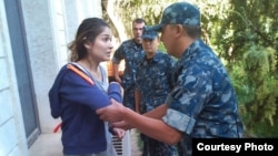 One of the last photographs of Gulnara Karimova, purportedly showing her being put under house arrest in 2014.