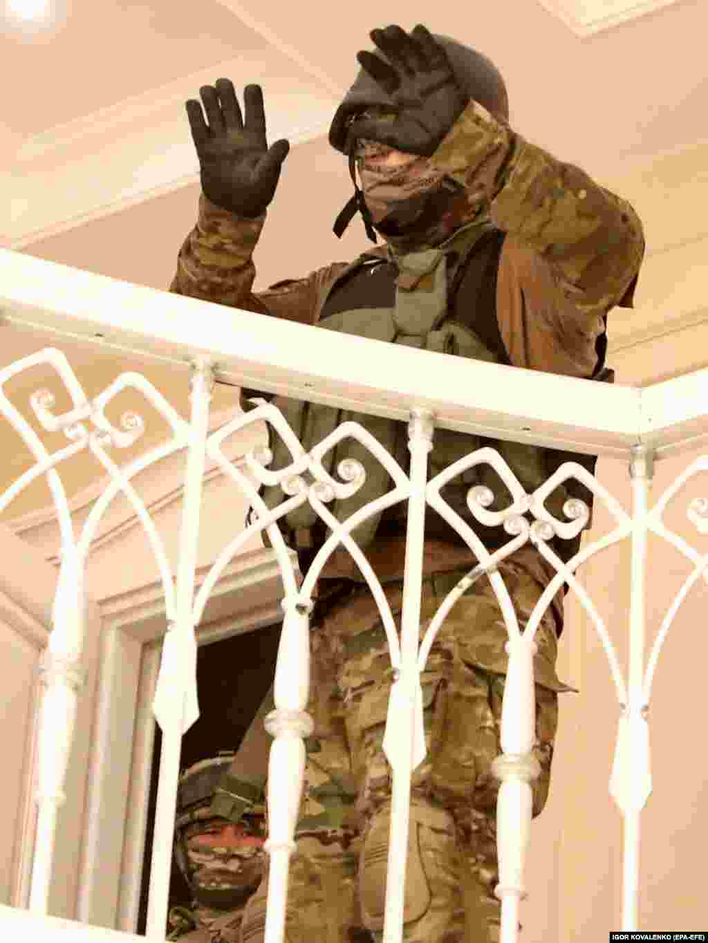 Special-forces troops surrender inside Atambaev's residence.