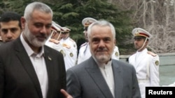 Iran's First Vice President Mohammad Reza Rahimi (right) welcomes Hamas leader Ismail Haniyeh to Tehran on February 10.