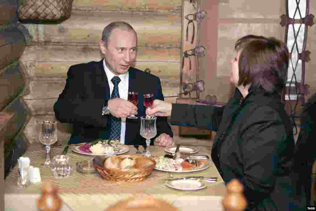 Vladimir Putin and Lyudmila dine at a restaurant serving Siberian cuisine in Moscow after voting in the Duma elections in December 2007.