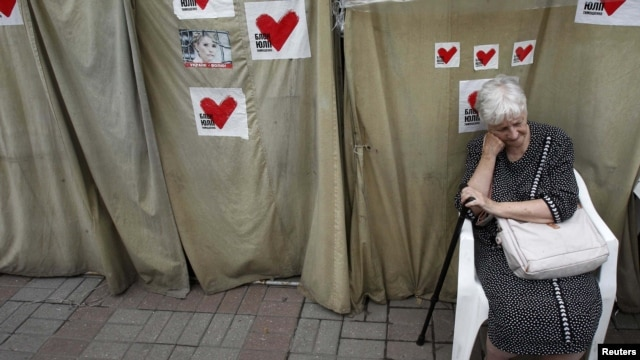 A Tymoshenko supporter sits in a protest tent camp in central Kyiv in mid-June.