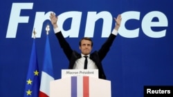 France -- Emmanuel Macron celebrates after partial results in the first round of 2017 French presidential election, at the Parc des Expositions.