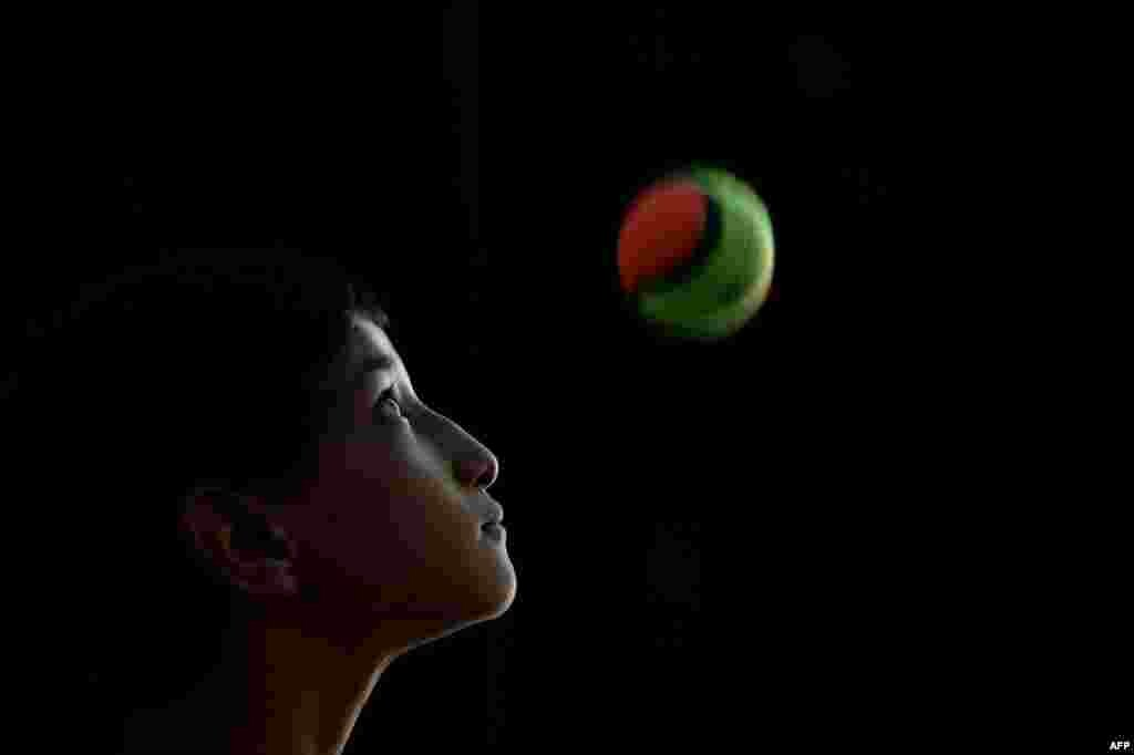 Shah Hussain, 12, performs during the 8th Afghanistan Juggling Championships.