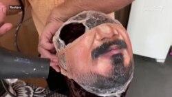 برازیلی هنرمند خلکو ته د هغوی د څهرې ماسکونه جوړوي