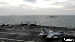 مقاتلة على حاملة طائرات أميركية في الخليج