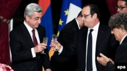 France - French President Francois Hollande (R) and Armenian President Serge Sarkissian (L) raise their glasses during a state dinner at the Elysee Palace in Paris, France, 08 March 2017