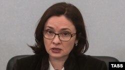 Председатель Центрального банка России Эльвира Набиуллина на пресс-конференции в Москве. 11 декабря 2014 года.