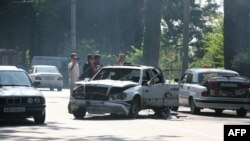 Investigators work at the scene of a bomb blast in Georgia's volatile breakaway region of Abkhazia. Much of the ethnic tensions that pervade the post-Soviet space can be attributed to Stalin-era nationalities policies.