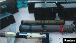 Weapons, said to be seized by Saudi-led coalition forces on an Iranian boat, are seen in an image released by the Media Office Of Saudi-led Coalition In Yemen. File photo