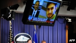U.S. Attorney General Eric Holder (center) answers questions during a press briefing regarding the investigation into the attempted bombing in Times Square.