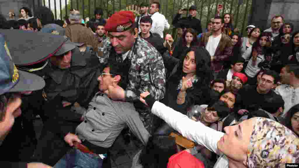 Riot police detain young opposition activists in Yerevan.