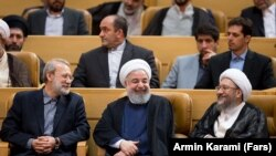 Iranian president Hassan Rouhani with the speaker of parliament and the head of judiciary. File photo