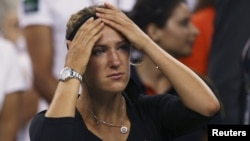 Victoria Azarenka of Belarus reacts after her defeat to Serena Williams in their women's singles finals match at the U.S. Open tennis tournament in New York on September 9.